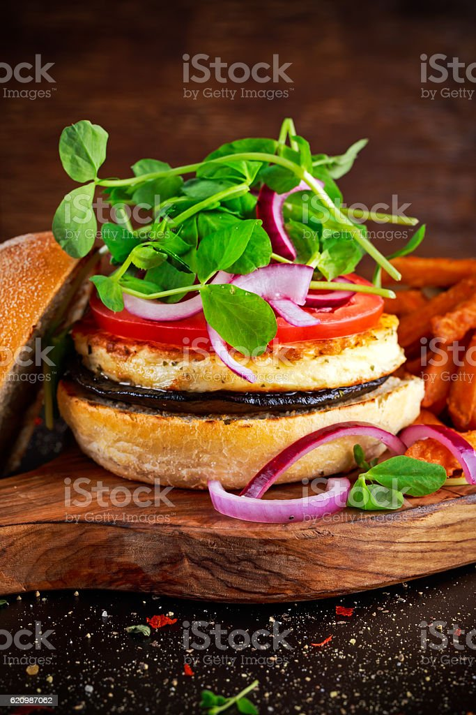 Halloumi cheese, mushroom Burger with sweet potatoes fries. concept of stock photo