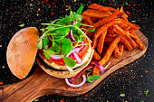 Halloumi cheese, mushroom Burger with sweet potatoes fries. concept of