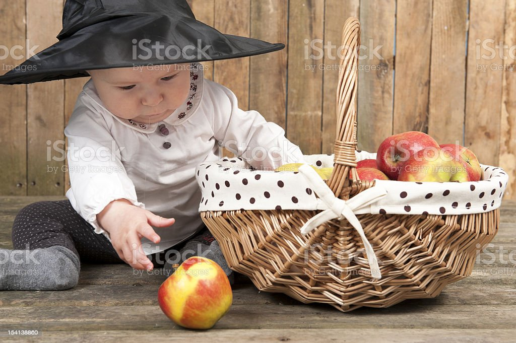 halloween baby with basket of apples royalty-free stock photo