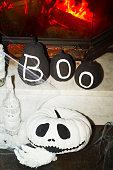 Halloween black and white pumpkin head jack over fireplace