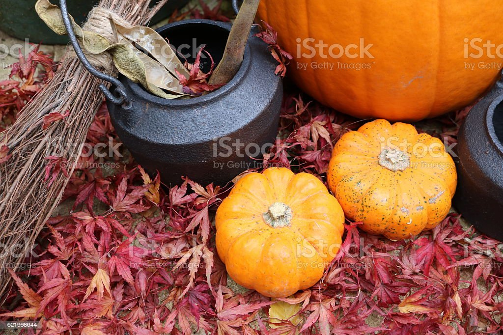 Halloween broomstick cauldrons and pumpkins stock photo