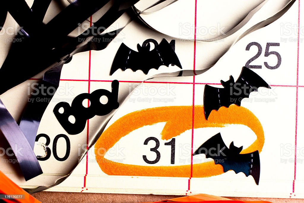 Halloween calendar date circled in orange with bats and BOO! stock photo