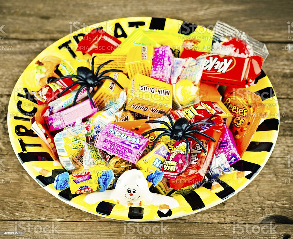 Halloween Candies in Trick or Treat Bowl stock photo