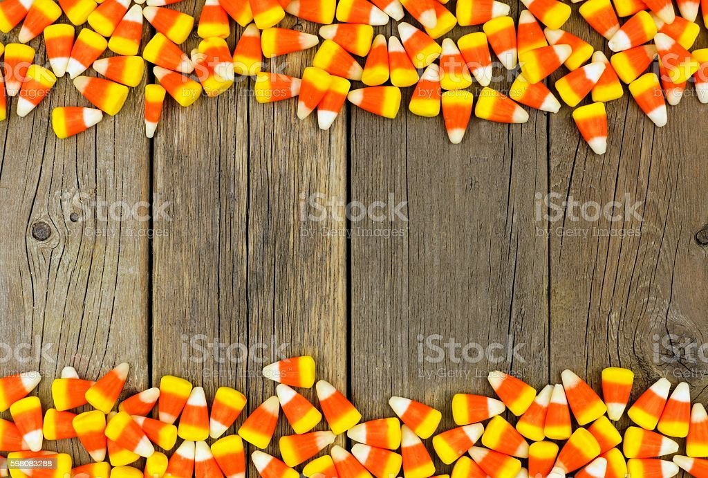 Halloween candy corn double border over old wood stock photo