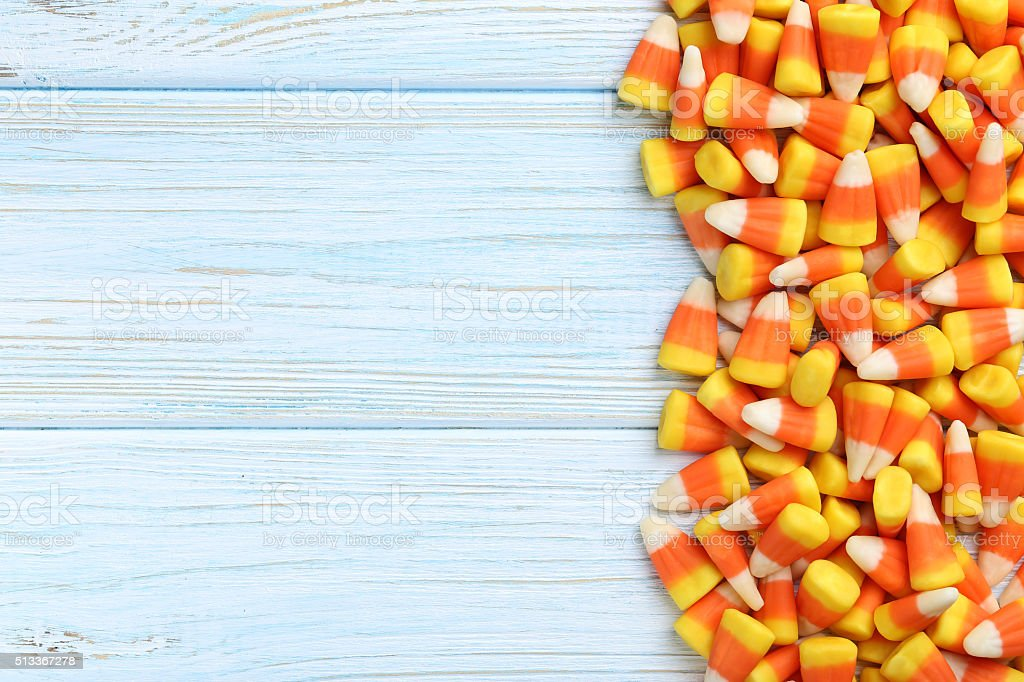 Halloween candy corns on blue wooden background stock photo