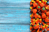 Halloween candy corns on blue wooden background