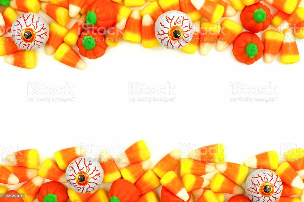 Halloween candy double border over white stock photo