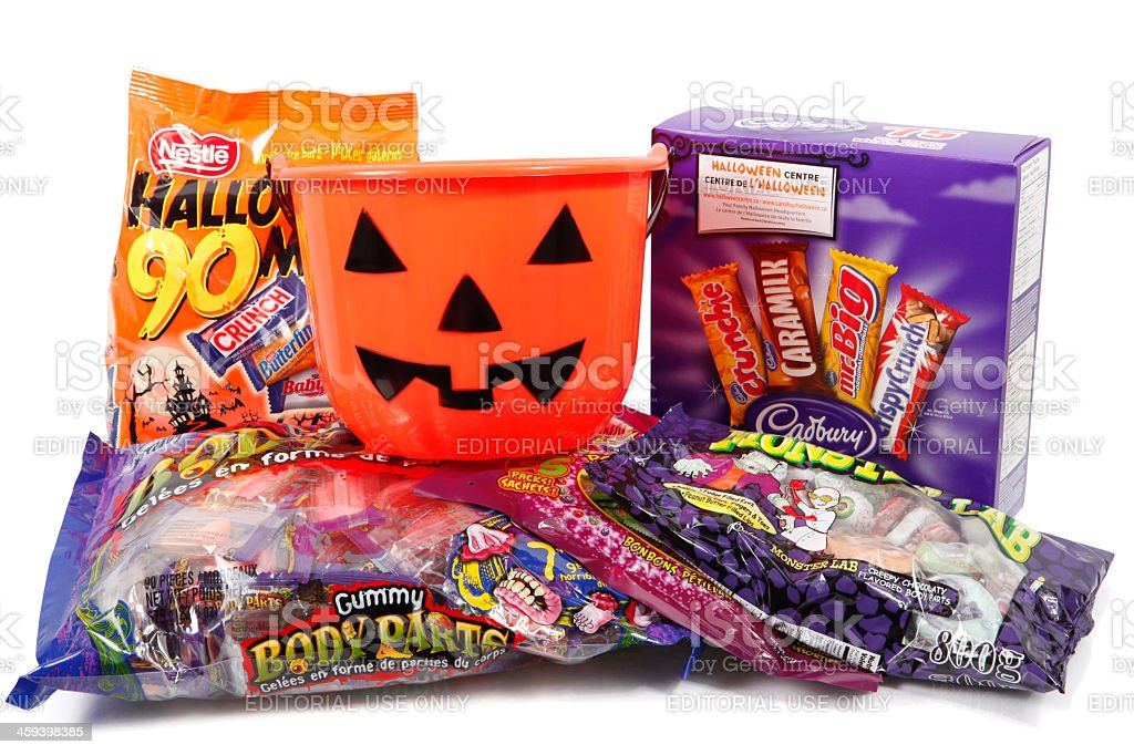 Halloween Candy Packages and Pumpkin Pail stock photo