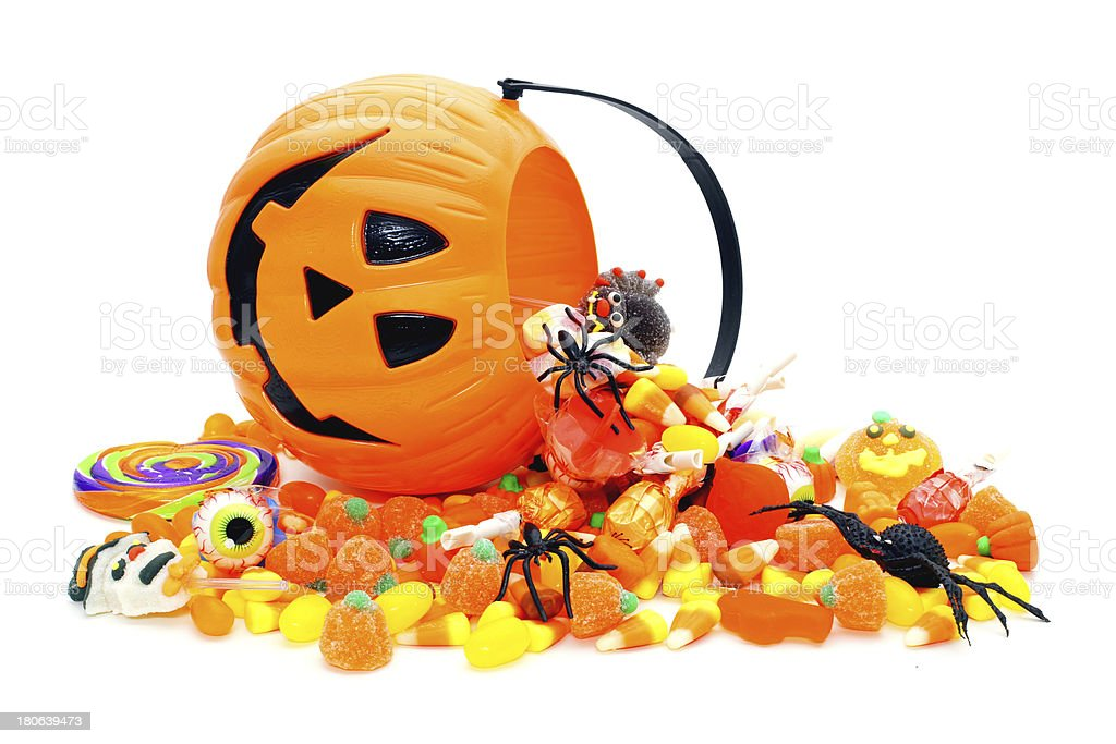 Halloween candy spilling from Jack o Lantern pail stock photo