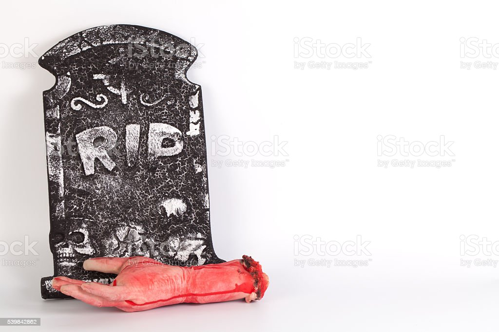 Halloween concept, zombie hand rising out from the ground isolat stock photo