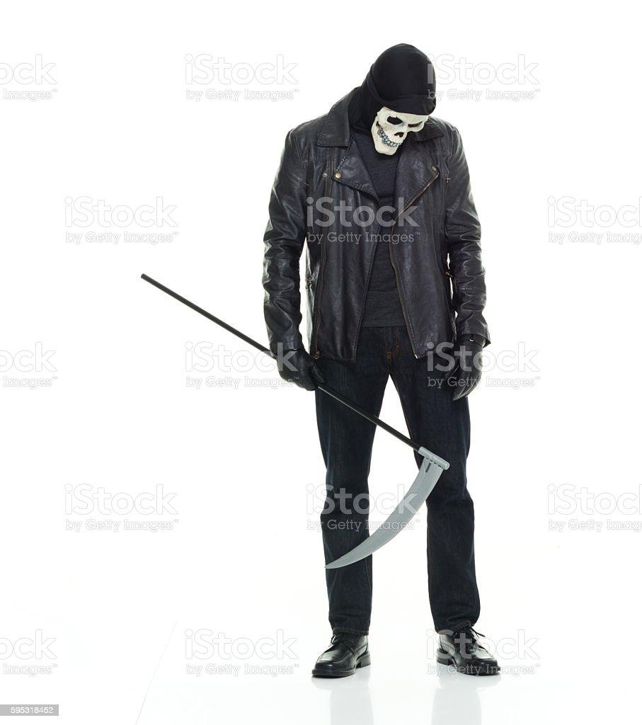 Halloween costume man holding scythe stock photo