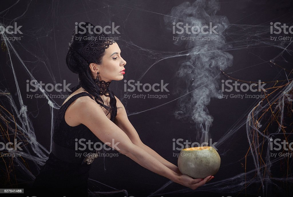 Halloween costume wicked witch and her magic potion stock photo