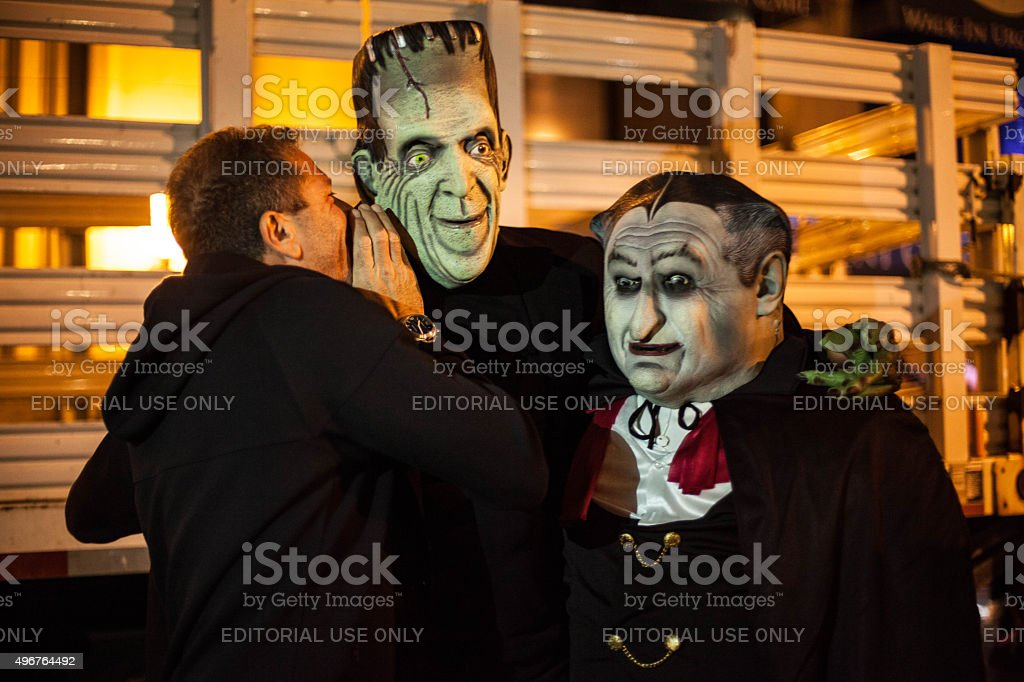 Halloween costumes. Herman and grandpa munster. stock photo