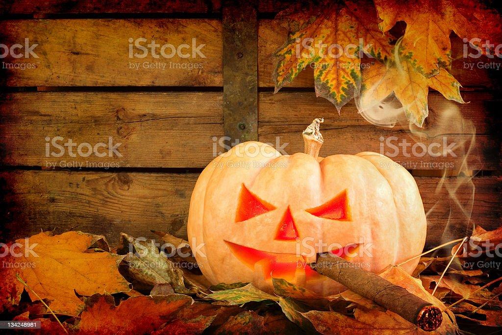 Halloween creepy pumpkin smoking cigar royalty-free stock photo