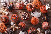 Halloween cupcakes and gingerbread cookies. horizontal top view