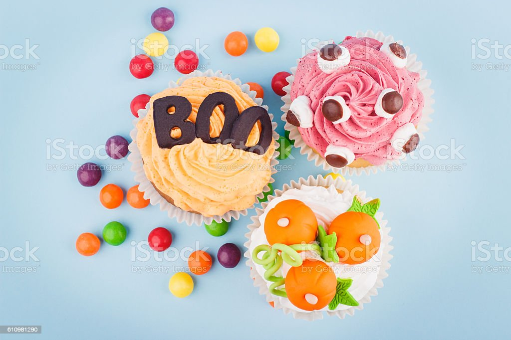 Halloween cupcakes with colored decorations stock photo