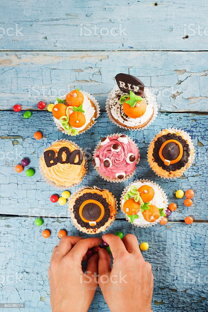 Halloween cupcakes with colored mastic decorations stock photo