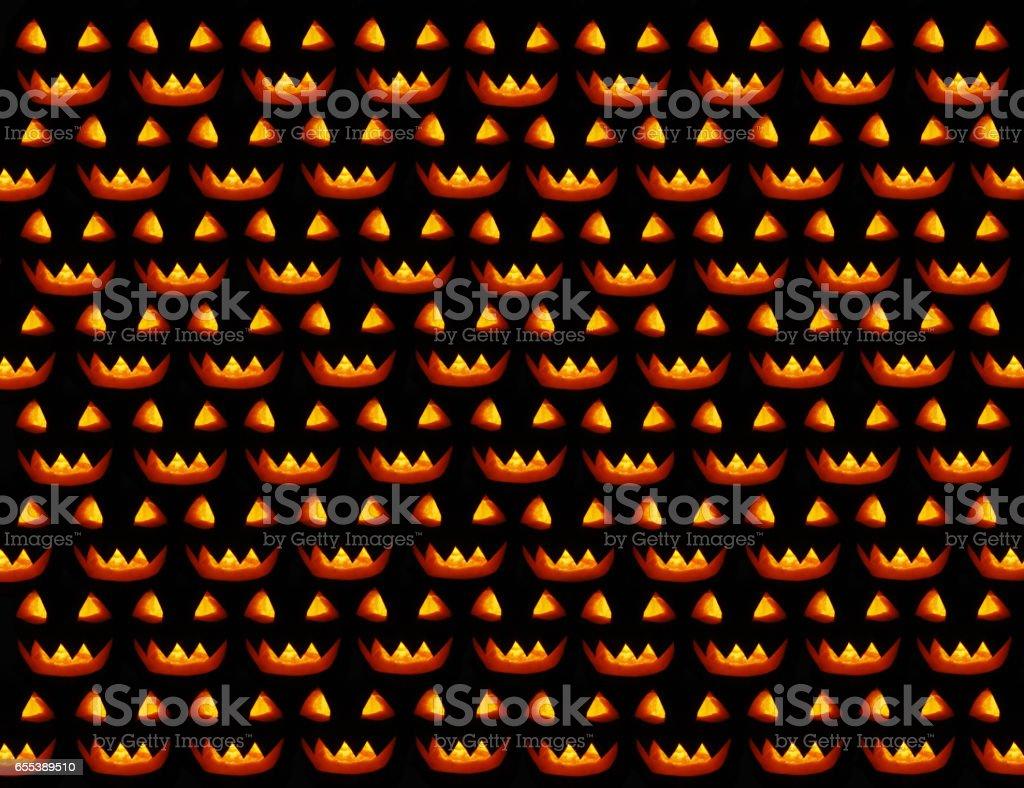 Halloween dark texture with bright glowing masks stock photo