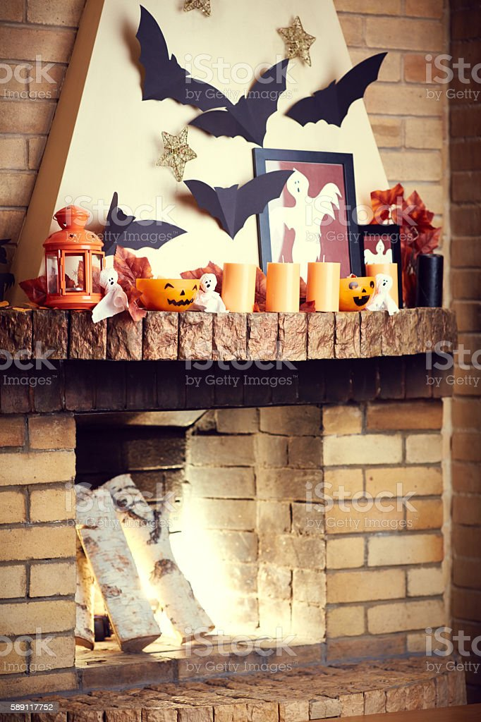 Halloween decor with brick fireplace and spooky decoration stock photo