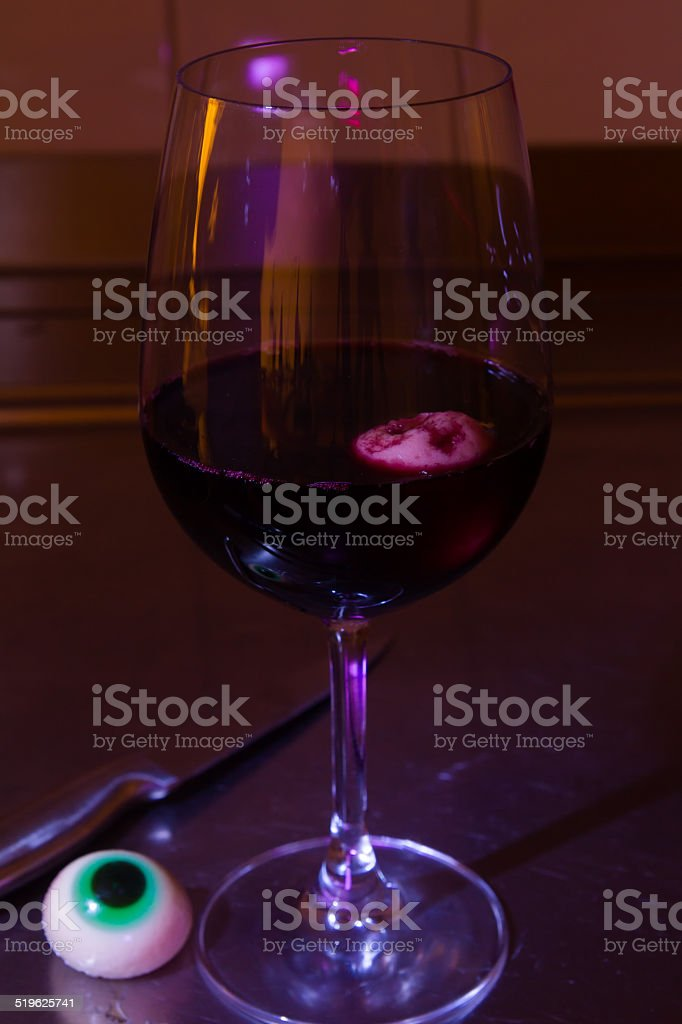 Halloween eyes in a redwine glass stock photo