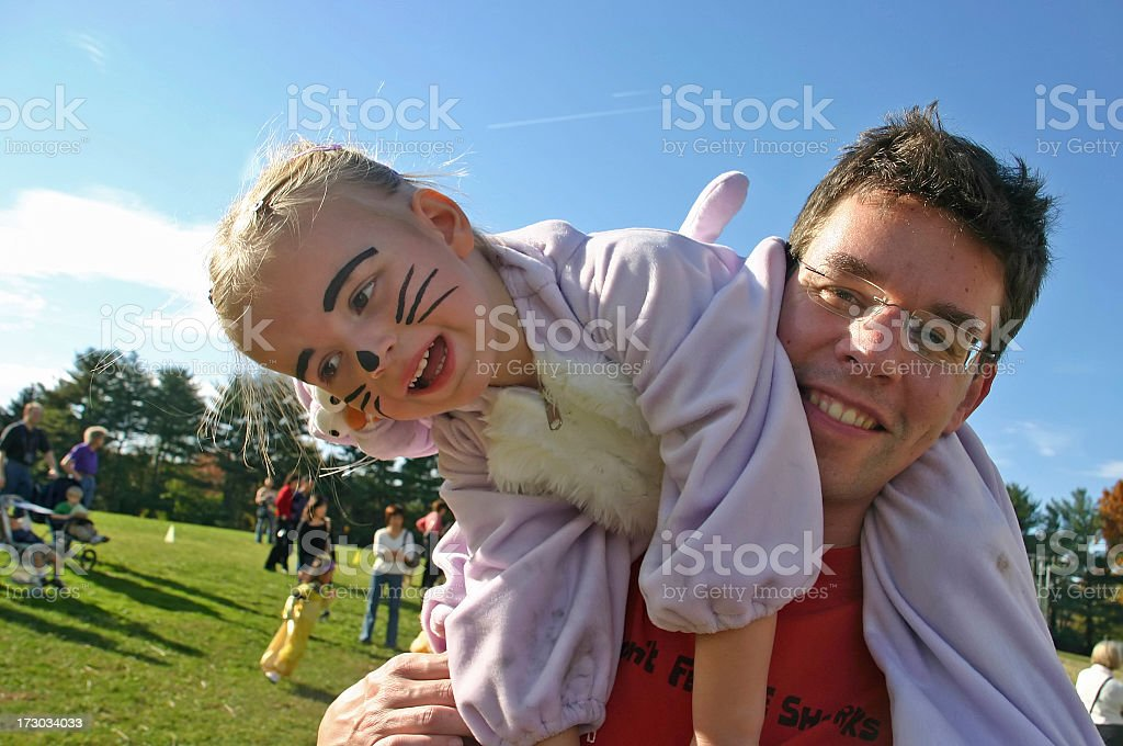 Halloween Family Fun - young girl with father stock photo
