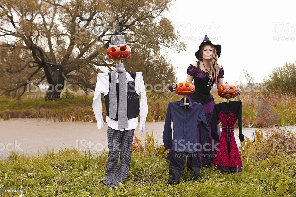 Halloween family. Witch and pumpkins royalty-free stock photo