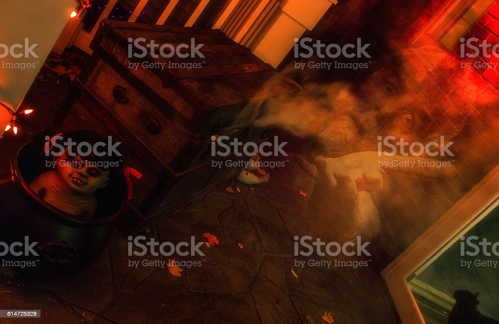 Halloween Genie Escaping From Ancient Dilapidated Steamer Trunk stock photo