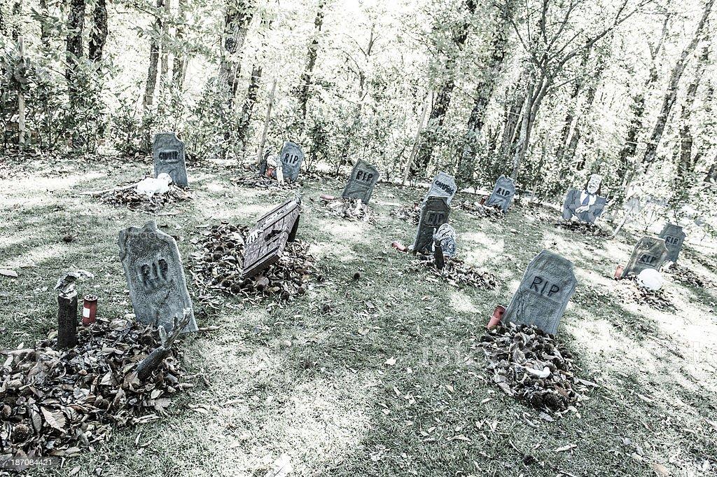 Halloween Graveyard with Zombie Raising Dead royalty-free stock photo