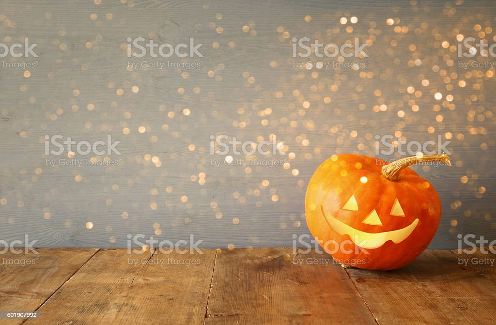 Halloween holiday concept. Cute pumpkin on wooden table stock photo