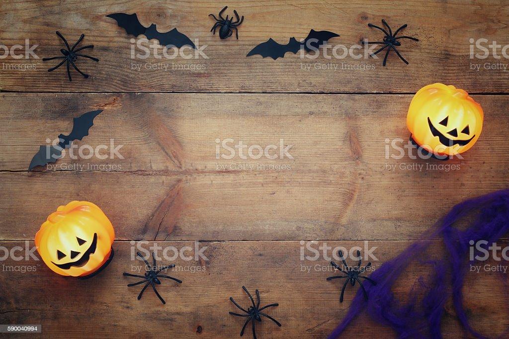 Halloween holiday concept top view. Pumpkins, spiders, bats stock photo