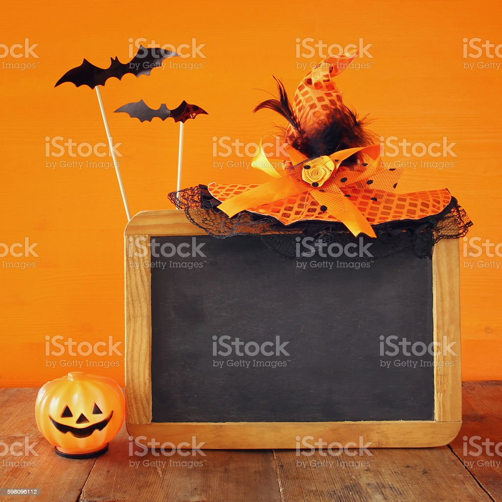 Halloween holiday concept. Witch hat, cute pumpkin stock photo