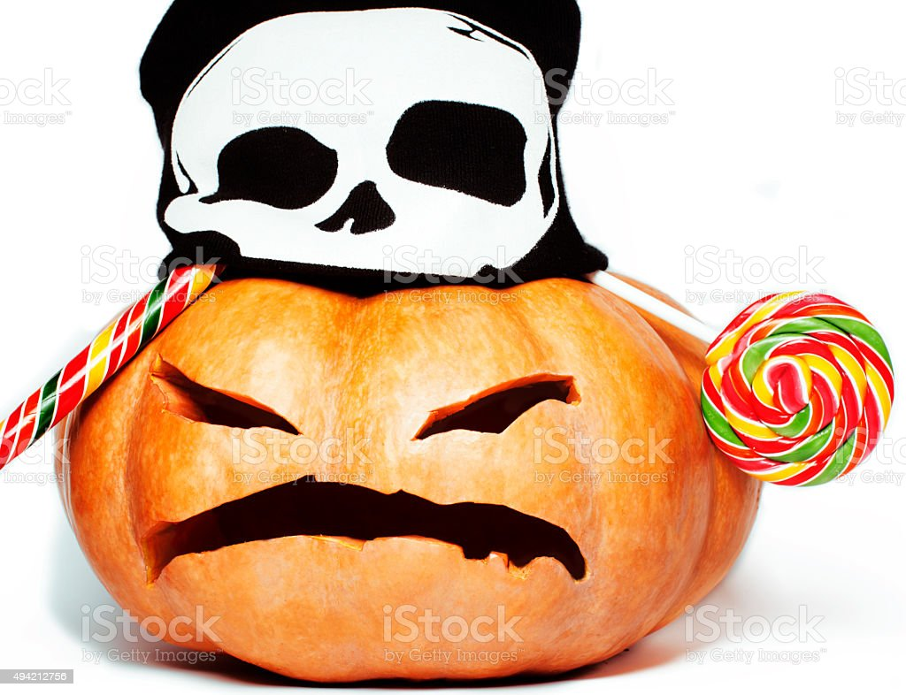 halloween holiday traditional scary smiling orange pumpkin in black skull stock photo