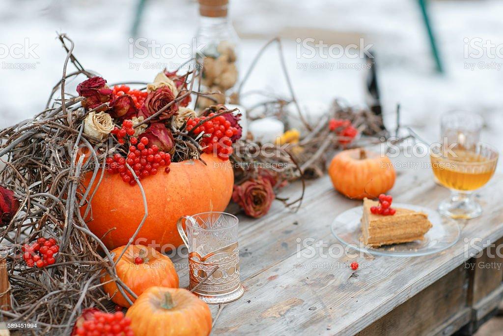halloween inspiration. Autumn still life. pumpkin, dry roses, viburnum honey stock photo