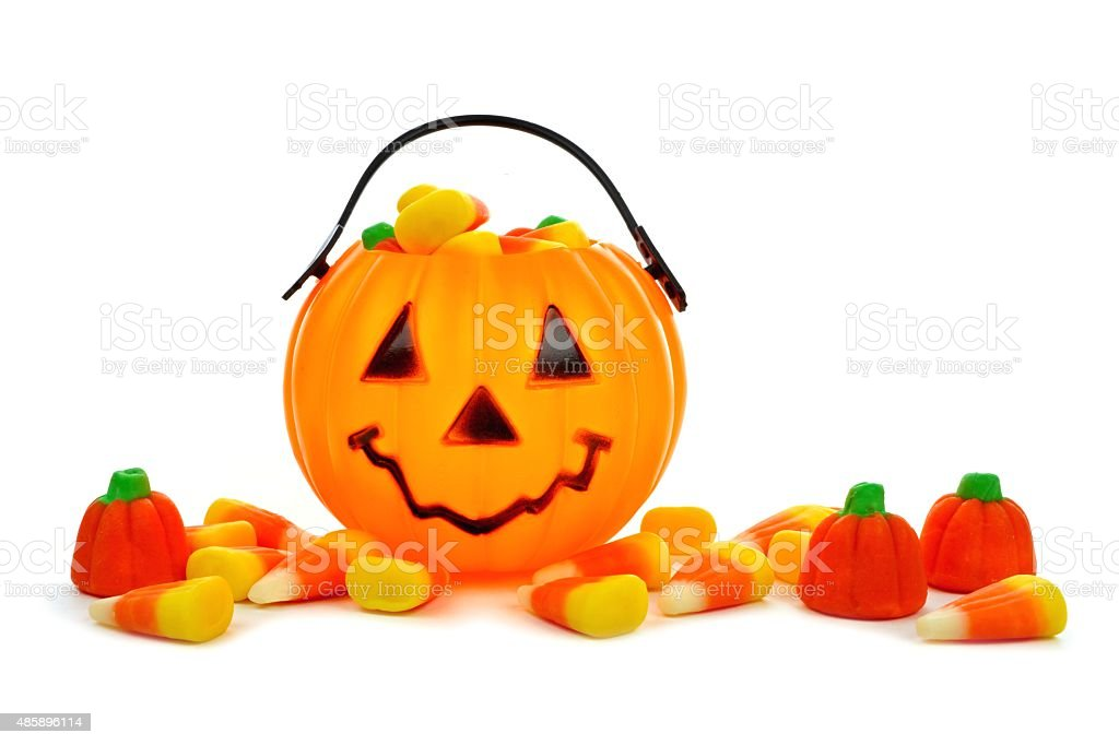 Halloween Jack o Lantern candy collector with scattered candies stock photo