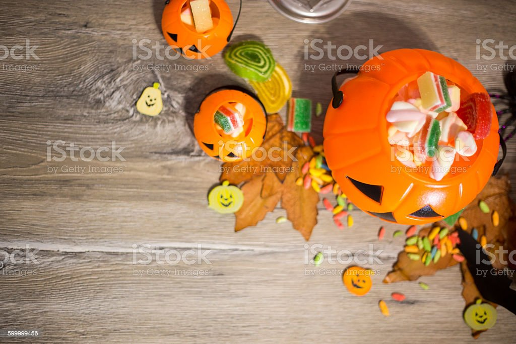 Halloween Jack o Lantern pail overflowing with candy stock photo