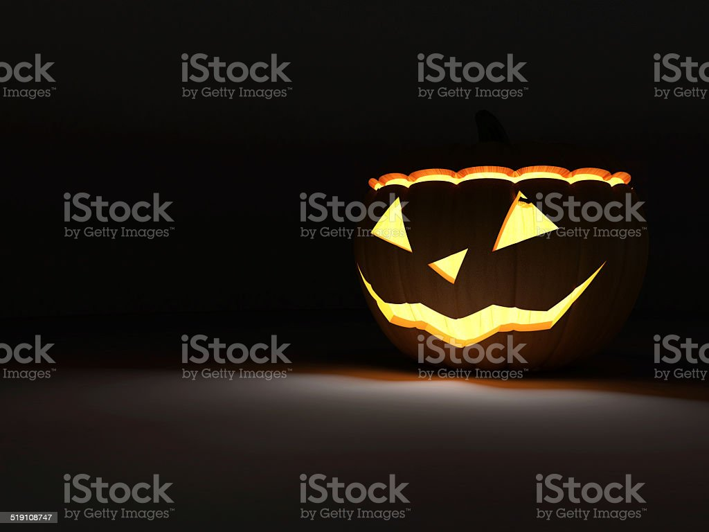 Halloween Jack O Lantern Pumpkin on dark background stock photo