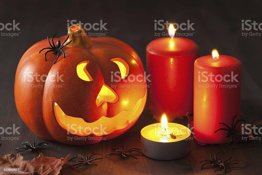 Halloween Jack O Lantern pumpkin spiders candles stock photo