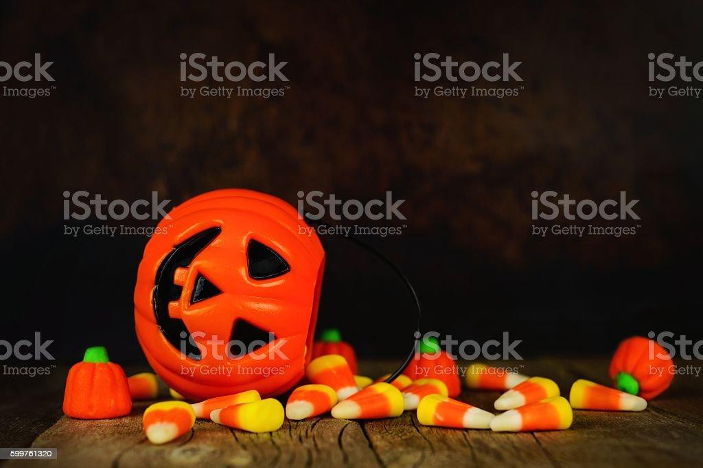 Halloween Jack-o-Lantern candy holder with orange and black background stock photo