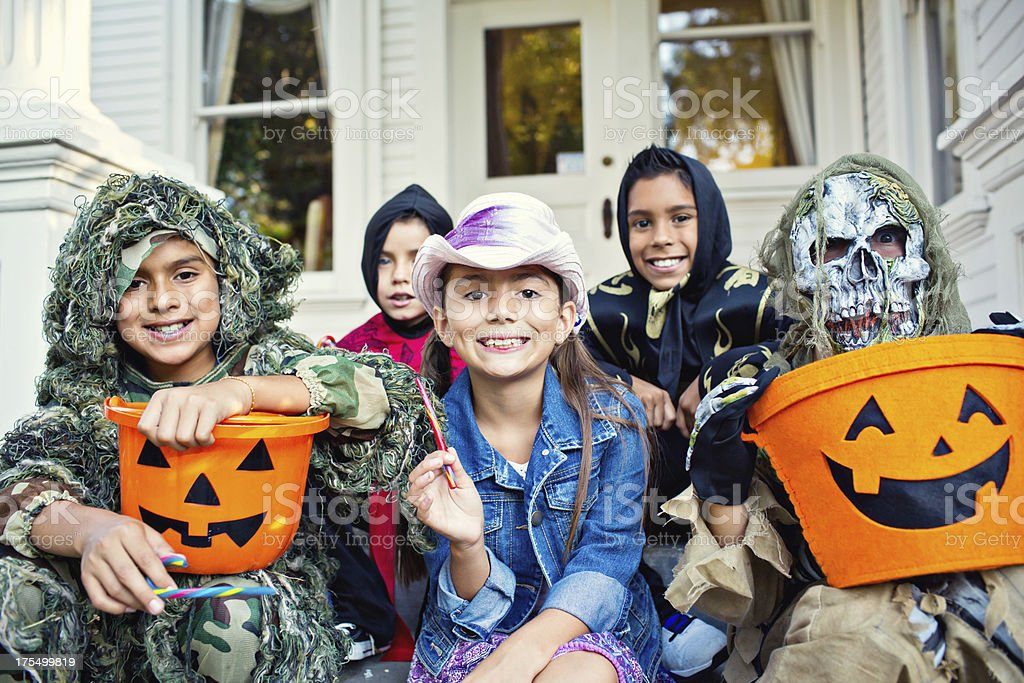 halloween kids on victorian house porch royalty-free stock photo