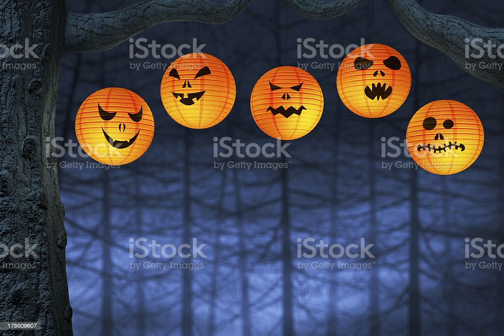 Halloween lanterns in a dark and spooky forest royalty-free stock photo