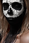 Halloween Makeup Ideas. White Skull on black Face