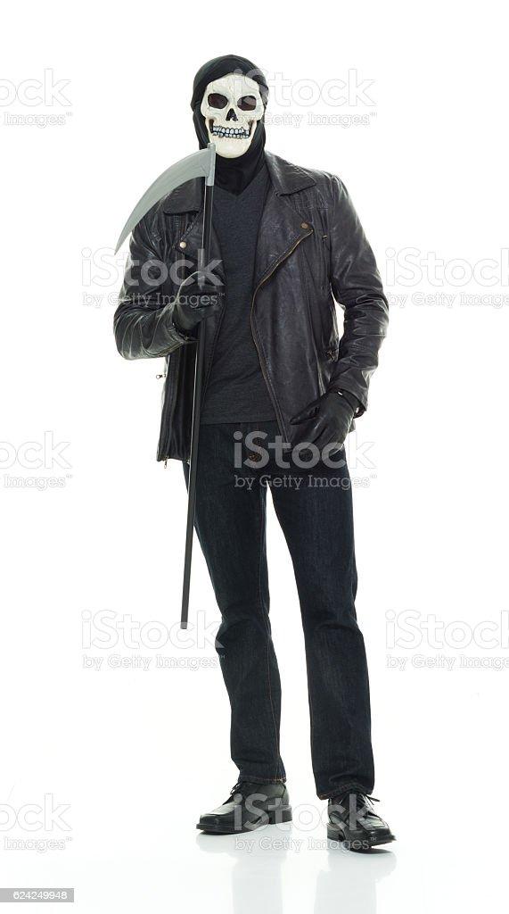 Halloween man holding scythe stock photo