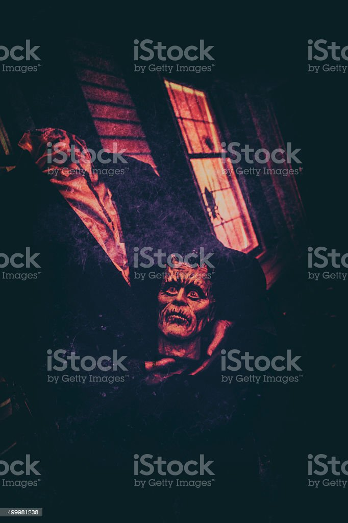 Halloween Monster Holding His Decapitated Head In His Lap stock photo