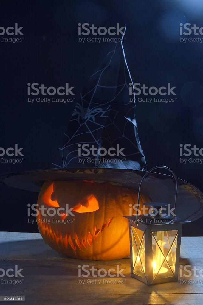 Halloween night jack'o lantern witch hat with lantern on black stock photo