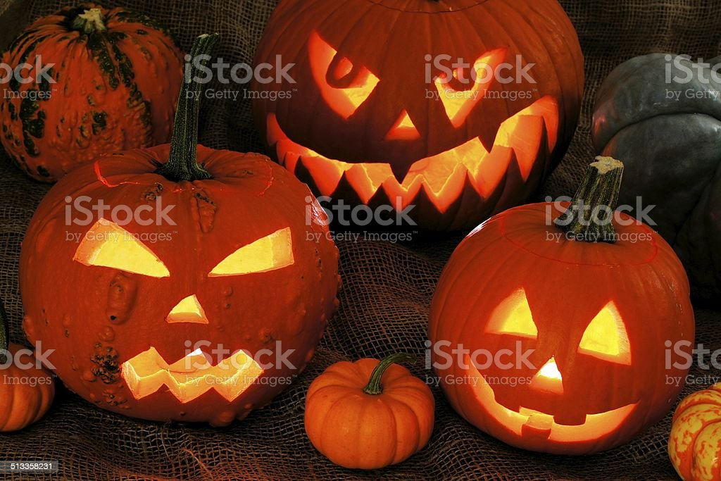 Halloween night scene with glowing Jack o Lanterns stock photo