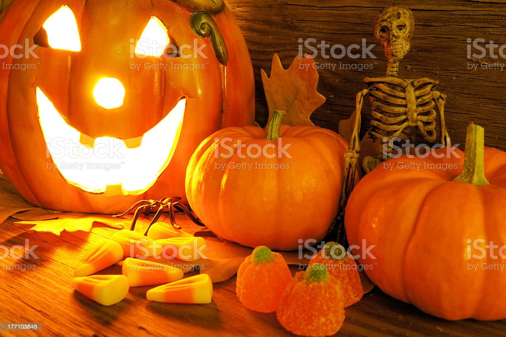 Halloween night scene with Jack o Lantern and candy royalty-free stock photo