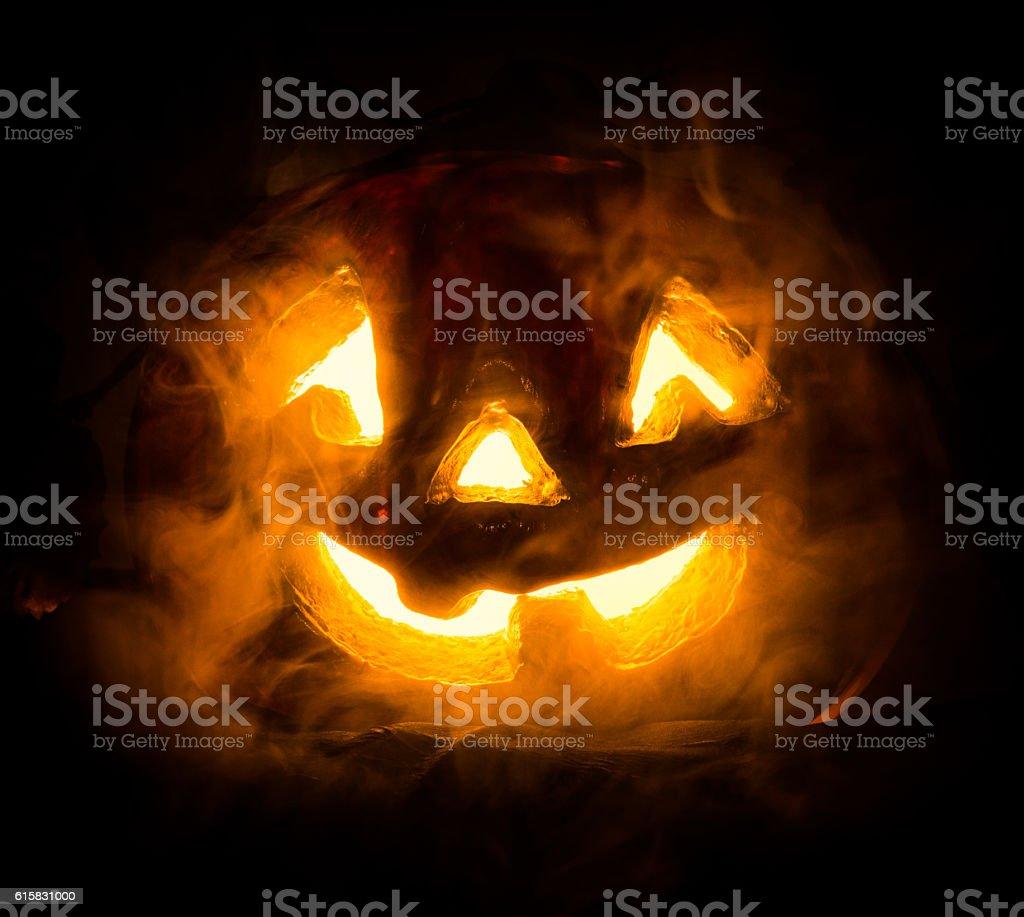 Halloween - old jack-o-lantern on black background stock photo