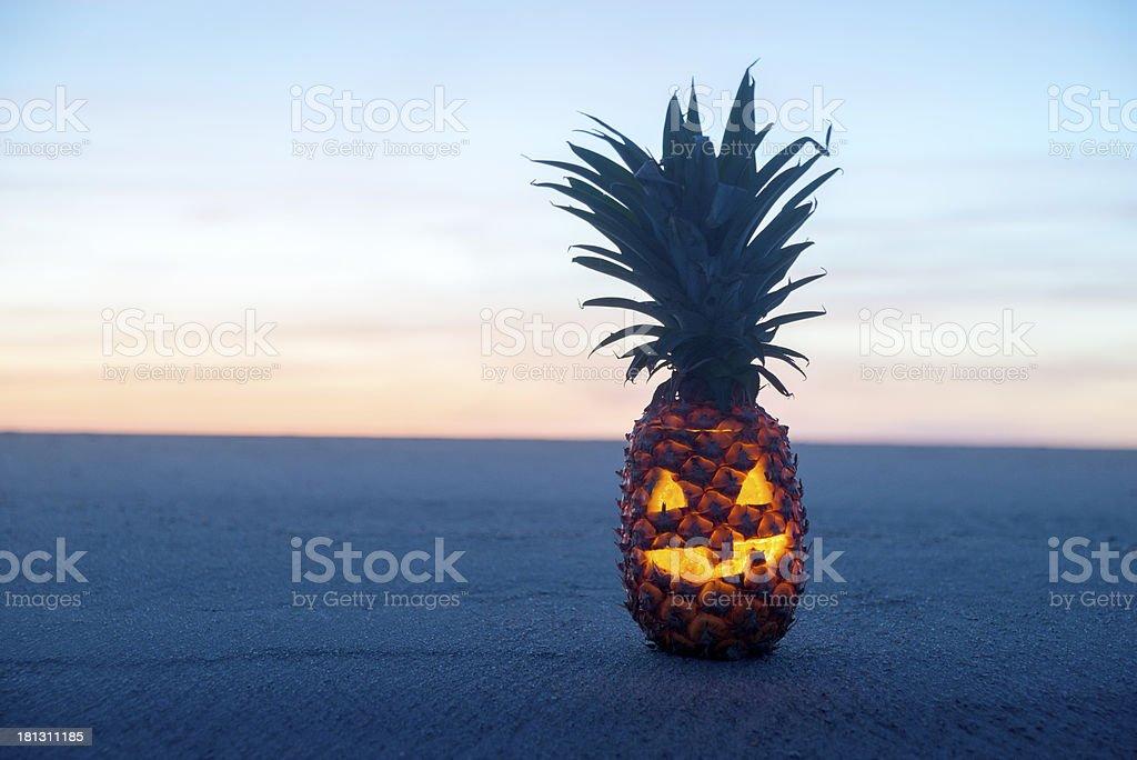 Halloween on Beach. Pinapple jack o lantern stock photo
