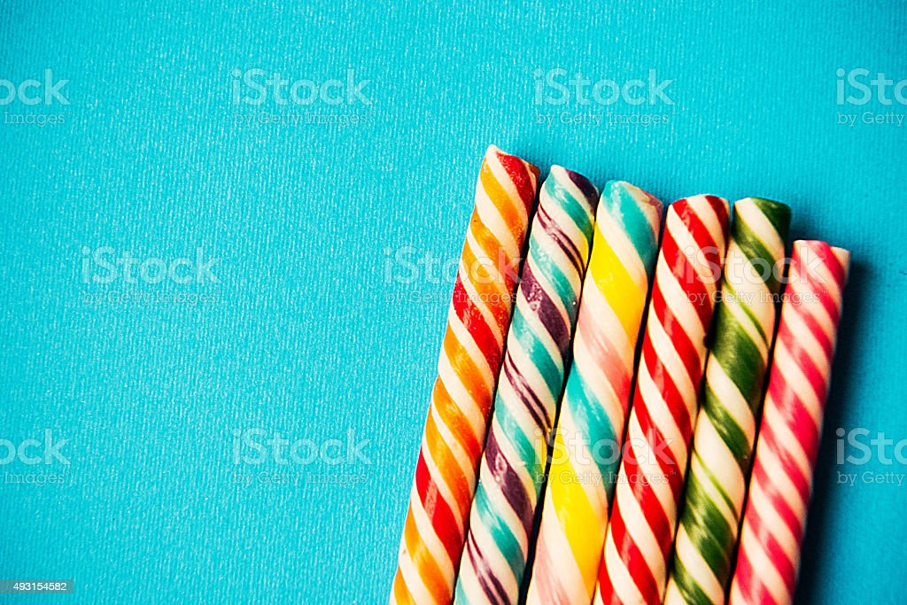 Halloween or Christmas candy - sweet food background on blue stock photo