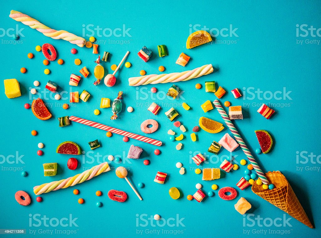 Halloween or Christmas candy - sweet food concept on blue stock photo